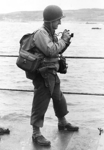 Captain Herman V. Wall, Commanding Officer, 165th Signal Photo Co. Date: D-Day, 6 June 1944Place: English ChannelTime: Pre-Normandy Invasion © 1978 Herman V. Wall - Image 13651_0001