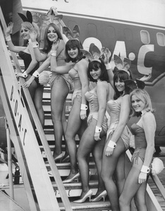 Playboy Bunniesboarding a plane at the London airport for a flight to Chicago.  The girls are winners of the National Playboy Bunny Hunt contestOctober 14, 1965 - Image 13801_0004