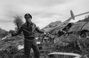"Frank Sinatra standing next to airplane wreckage for ""Von Ryan"