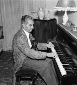 """Charles """"Lucky"""" Luciano at home with his music and pet Doberman Pinschercirca 1955 - Image 13924_0006"""
