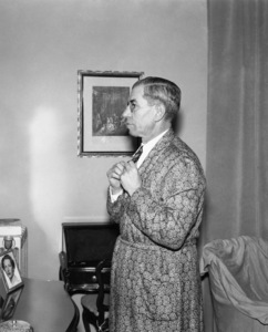 """Charles """"Lucky"""" Luciano checks his get up in Naples, Italycirca 1955 - Image 13924_0011"""