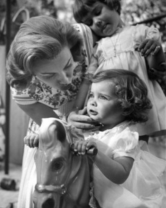 Linda Christian with daughters Taryn (Foreground) and Romina (background) at home, 1955. © 1978 Sid Avery - Image 13998_0001
