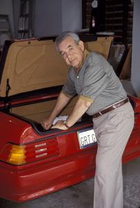 Tom Bosley looking through the trunk of his 1992 500SL Mercedes1992 © 1992 Gene Trindl - Image 14149_0005