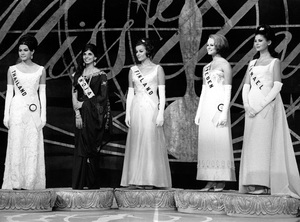 """Pageants: Miss Universe""Five semi-finalists (left to right) Miss Thailand, Miss India, Miss Finland, Miss Sweden and Miss Israel, stand tensely waiting for the judges to announce the next Miss Universe1966 - Image 14915_0002"