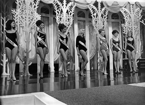 """""""Pageants: Miss World""""Pictured during the swimsuit line-up at the final of the 1966 Miss World Beauty Contest are, left to right: Miss Brazil, Miss India, Miss Greece, Miss Italy, Miss Norway, Miss U.S.A. and Miss Yugoslavia - Image 14917_0001"""