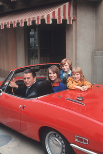 """To Rome With Love""John Forsythe,Joyce Menges,Susan Neher,Melanie FullertonIn Their Fiat 850 Spider1970 © 1978 Gene Trindl - Image 1596_0005"