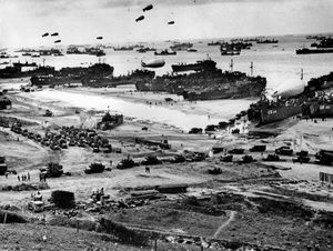 World War II / Allied convoys are massed offshore at Omaha Beach as LST