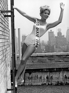 """Pageants: Various""Karol Kelly atop the Hotel Manhattan in New York is the newly elected Miss Dixie of 1966 - Image 16095_0001"