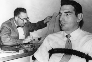 Polygraph expert Sidney McMain (left) inspects results of lie detector test he