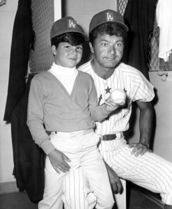 Dick Shawn and son in the locker-room for a celebrity baseball game1966Photo by Joe Shere - Image 16943_0001