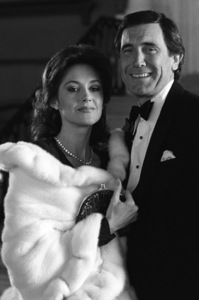 George Lazenby and Susan Orwell during the making of a Lincoln Continental commercial1982 © 1982 Ron Avery - Image 16987_0002