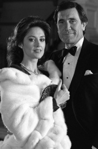 George Lazenby and Susan Orwell during the making of a Lincoln Continental commercial1982 © 1982 Ron Avery - Image 16987_0003