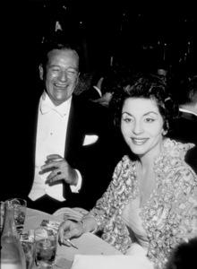 """""""Academy Awards: 32nd Annual,""""John Wayne and wife Pilar.  1960. © 1978 David Sutton - Image 1757_0030"""