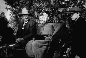 """The Shootist,"" Paramount 1976.John Wayne, Lauren Bacall, and Ron Howard. © 1978 David Sutton - Image 1797_0016"