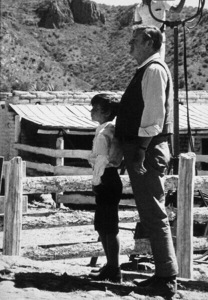 """Big Jake,"" Batjac/Cinema Center 1970.John Wayne and his son, Ethan, during filming. © 1978 David Sutton - Image 1798_0003"