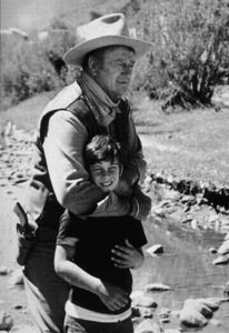 """Big Jake,"" Batjac/Cinema Center 1970.John Wayne and his son, Ethan. © 1978 David Sutton - Image 1798_0026"