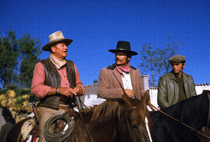 """""""Big Jake,"""" Batjac/Cinema Center 1970.John Wayne, Patrick Wayne, and Chris Mitchum. © 1978 David Sutton - Image 1798_0042"""