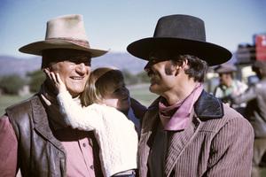 """Big Jake"" John Wayne, his grandson, Ian, and his son, Patrick, during a break from filming1970© 1978 David Sutton - Image 1798_0043"