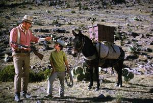 """Big Jake,"" Batjac/Cinema Center 1970.John Wayne and his son, Ethan. © 1978 David Sutton - Image 1798_0048"