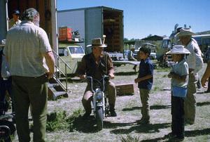 """Big Jake,"" Batjac/Cinema Center 1970.John Wayne and his son, Ethan, during a break from filming. © 1978 David Sutton - Image 1798_0049"