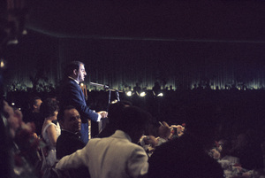 """Cedars-Sinai Benefit / Party""(at microphone) Danny Thomas (seated to his left) Elizabeth Taylor (looking at camera) Frank Sinatracirca 1961 / The Beverly Hilton © 1978 David Sutton - Image 1807_0002"