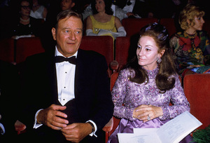 """Academy Awards - 42nd Annual,"" 1970.John Wayne and his wife, Pilar.Best Actor winner for ""True Grit."" © 1978 David Sutton - Image 1812_0022"