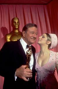 """Academy Awards: 42nd Annual,""John Wayne and Barbra Streisand.1970. © 1978 Bud Gray - Image 1812_0027"