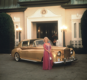 Zsa Zsa Gabor at home with her Rolls Royce, 1982. © 1982 Tom Kelley - Image 18_85
