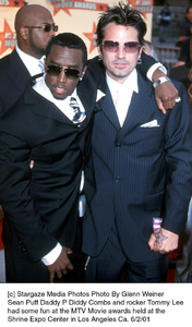 © Stargaze Media Photos Photo By Glenn WeinerSean Puff Daddy P Diddy Combs and rocker Tommy Leehad some fun at the MTV Movie awards held at theShrine Expo Center in Los Angeles Ca. 6/2/01 - Image 18389_0142