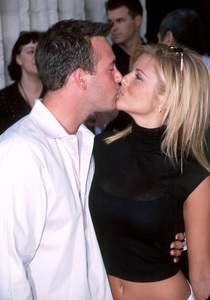 Tiffani Thiessen plants a kiss on boyfriend RichardRuccolo at the Premiere of Dr. Dolittle 2 held at the GCC Avco theater in Westwood California. 6/19/01 - Image 18577_0114