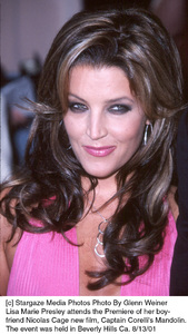 Lisa Marie Presley attends the premiere of boyfriend Nicolas Cage