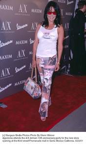Apollonia attends the A/X Armani 10th Anniversary party for the new store opening at the third street Promenade mall in Santa Monica California. 8/23/01. © 2001 Glenn Weiner - Image 19279_0101