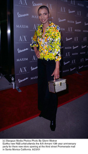 Eartha new R&B artist attends the A/X Armani 10th year Anniversary party for there new store opening at the third street Promenade mall in Santa Monica California. 8/23/01. © 2001 Glenn Weiner - Image 19279_0102