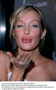 Blow us a kiss, Holly Fields gets a little friendly at the A/X Armeni 10th Anniversary party for there new store opening at the third street Promenade mallin Santa Monica California. 8/23/01. © 2001 Glenn Weiner - Image 19279_0105