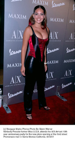 Kimberly Pressler former Miss U.S.A. attends the A/X Armani 10th year Anniversary party for the new store opening at the third street Promenade mall in Santa Monica California. 8/23/01. © 2001 Glenn Weiner - Image 19279_0116