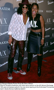 Slash & Sunshine Anderson both were set to perform at the A/X Armani Exchange 10th year Anniversary party for the new store opening at the third street Promenade mall in Santa Monica California 8/23/01. © 2001 Glenn Weiner - Image 19279_0128