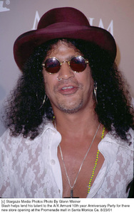 Slash helps lend his talent to the A/X Armani 10th year Anniversary Party for there new store opening at the Promenade mall in Santa Monica Ca. 8/23/01. © 2001 Glenn Weiner - Image 19279_0129