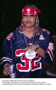 Da Brat gets a Red Bull and a metel for attending the world premiere of Hardball held at the Paramount studios lot in Hollywood California. 9/10/01. © 2001 Glenn Weiner - Image 19384_0104