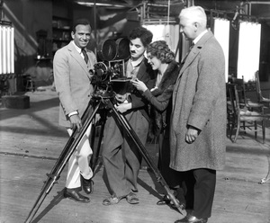 Douglas Fairbanks Sr., Charlie Chaplin, Mary Pickford and Oscar Price during the formation of United Artists1919** I.V. - Image 19560_0003