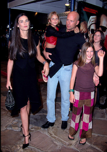 Bruce Willis stars in the new movie Bandits as he attends the premiere with his former wife Demi Moore and his three kids Rumer, Larue (Scout), and Tallulah, that he had with Demi. The premiere was held at the Mann Village theater in Westwood Ca. 10/4/01. © 2001 Glenn Weiner - Image 19588_0107