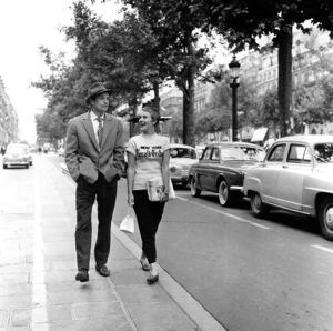 """Breathless"" (a.k.a. ""A bout de souffle"") Jean Seberg and Jean Paul Belmondoon the set, 1959. Imperia/**I.V. - Image 19595_0001"