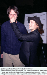 Drew Barrymore helps her husband Tom Green blow his nose at the premiere of the new film Donnie Darko.Drew is the executive producer of the film.The premiere took place at the Egyptian theatre in Hollywood Ca. 10/22/01. © 2001 Glenn Weiner - Image 19647_0101