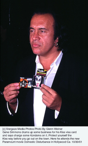 Gene Simmons drums up some business for his Kiss visa card and says charge some Kondoms on it. Protect yourself the Kiss way before you go out on the town. Here he attends the new Paramount movie Domestic Disturbance in Hollywood Ca. 10/30/01. © 2001 Glenn Weiner - Image 19661_0108