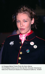 Connie Neilson buttons up for the new film, Domestic Disturbance held at the Paramount Studios lot in Hollywood California. 10/30/01. © 2001 Glenn Weiner - Image 19661_0110
