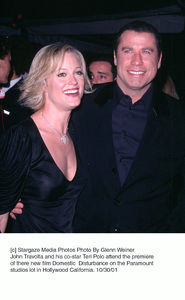 John Travolta and his co-star Teri Polo attend the premiere of there new film Domestic  Disturbance on the Paramount studios lot in Hollywood California. 10/30/01. © 2001 Glenn Weiner - Image 19661_0117