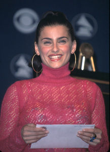 Nelly Furtado held the answer in her own hands as she helped read the nominations at the 44th annual Grammy awards nominations at the Beverly Hilton Hotel in Beverly Hills Ca. 1/4/02. © 2002 Glenn Weiner - Image 19782_0108