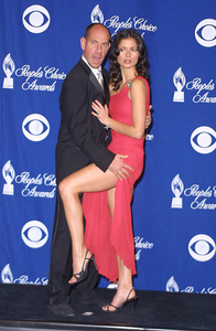 Jill Hennessy gets a leg up from her co-star Miguel Ferrer of the show Crossing Jordan at the 28th annual Peoples Choice awards in Pasadena California 1/13/02. © 2002 Glenn Weiner - Image 19804_0112