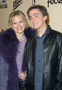 Frankie Muniz and his date Hilary Duff attend the Sizzlin Sixteen 2002 party held at Club A.D. in Hollywood California 1/30/02. © 2002 Glenn Weiner - Image 19855_0115