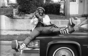 George Clinton, of Parliament-Funkadelic, sitting on a Cadillac limousine in Hollywood1977© 1978 Bobby Holland - Image 20242_0044