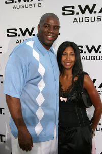"""""""S.W.A.T."""" Premiere 7-30-03Earvin """"Magic"""" Johnson and wifePhoto By Sam Kweskin - Image 21354_0060"""
